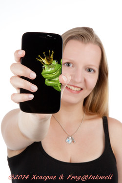 woman holding a phone with a frog on it with her hand