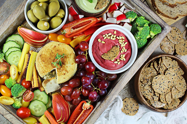 Veggie Charcuterie Board with Smoked Almond Cheese, Pink Hummus and Avocado Dip. .jpg