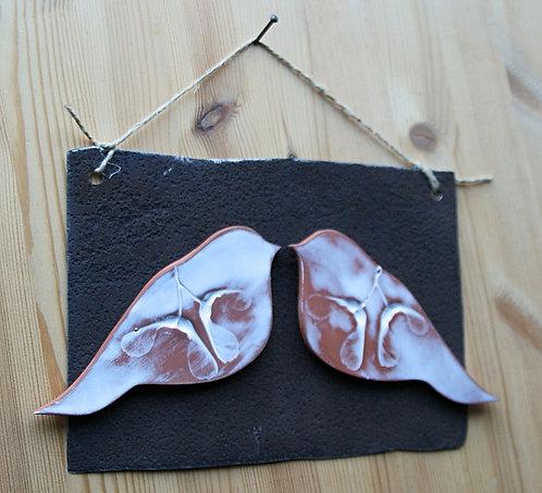 Ceramiczne ptaki na metalu