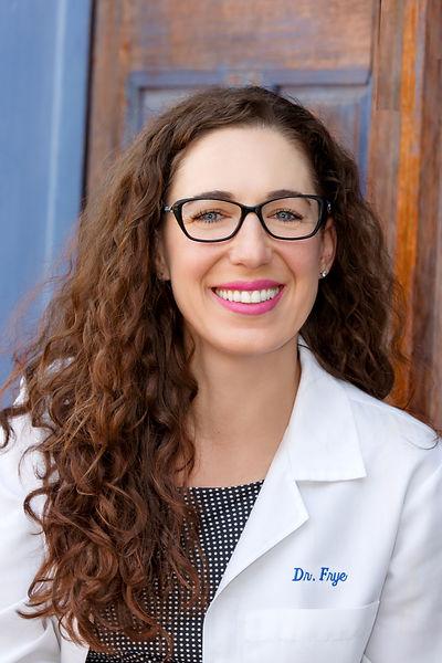 Dr. Frye in white coat
