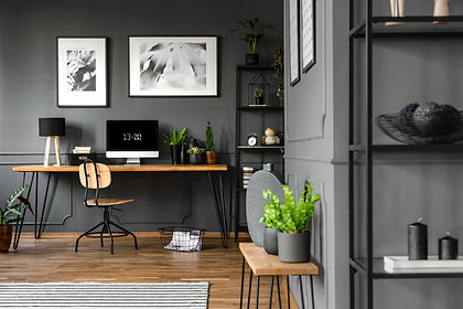 office with a desk computer clock and plants