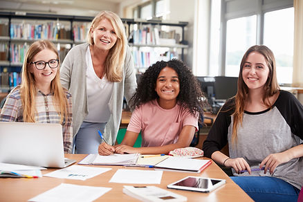 woman-teacher-working-with-female-colleg