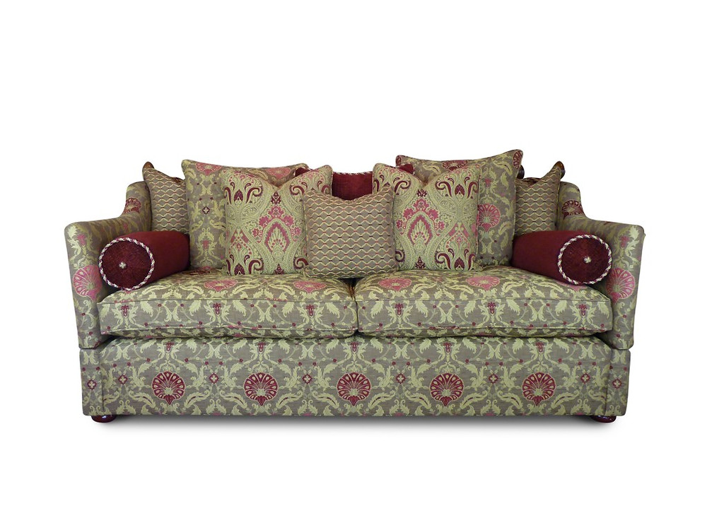Devon Knole Bespoke Sofa. A classic design with distinctive characteristics; hinged arms, scatter back cushions and bolsters add to it's comfort. Finials and tie backs are added to suit your personal taste and decor.