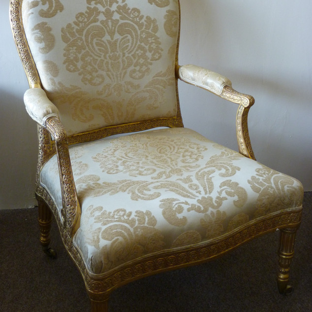 traditional re-upholstery of gold gilded
