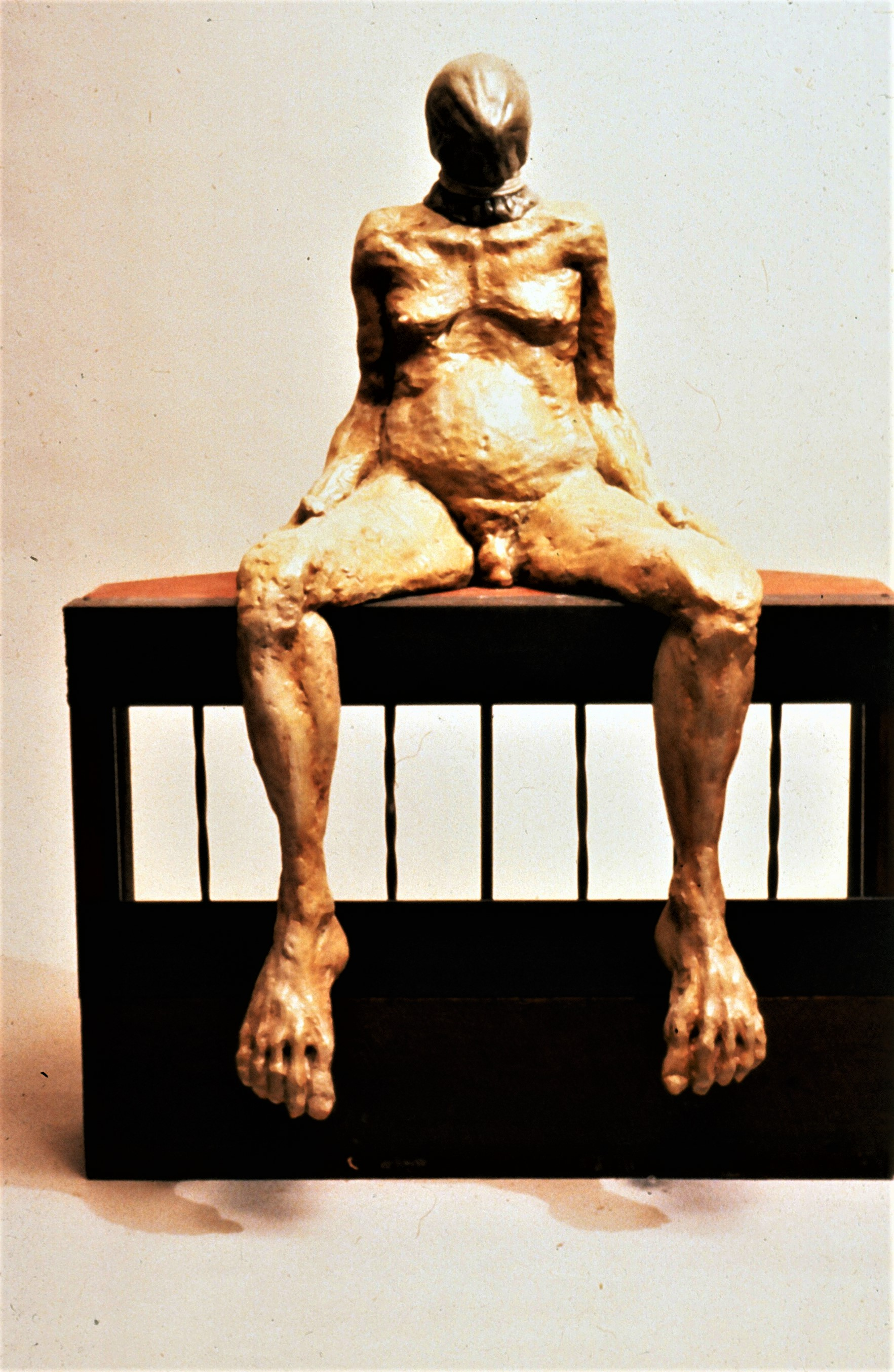 Sitting hooded figure