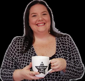 Ivi Serrano coach sonriendo con tza de café