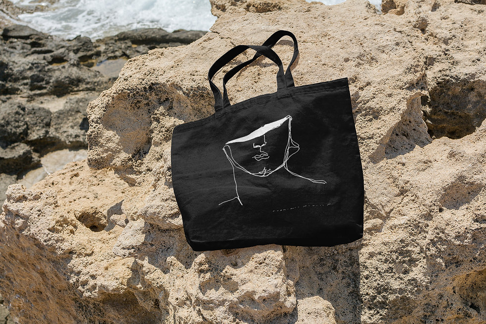 mockup-of-a-tote-bag-lying-on-a-rock-by-