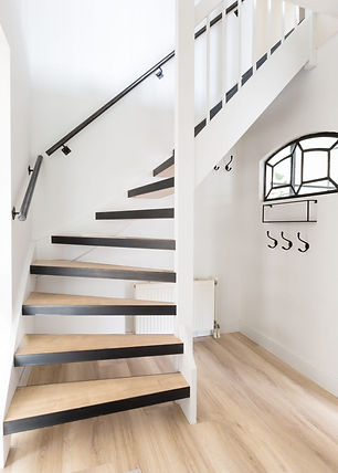 the-staircase-in-the-mudroom-is-made-of-raw-steel-kickplates-and-treads-created-from-local