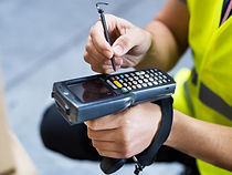 male-warehouse-worker-with-barcode-scanner-PL29XGQ.jpg