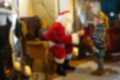 Good pic santa gives child present.JPG