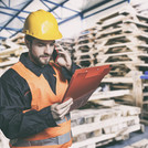 Worker in protective uniform in front of