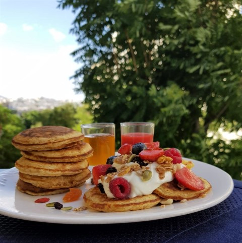 Breakfast on the balcony - Pancakes topped with yogurt, berries & granola