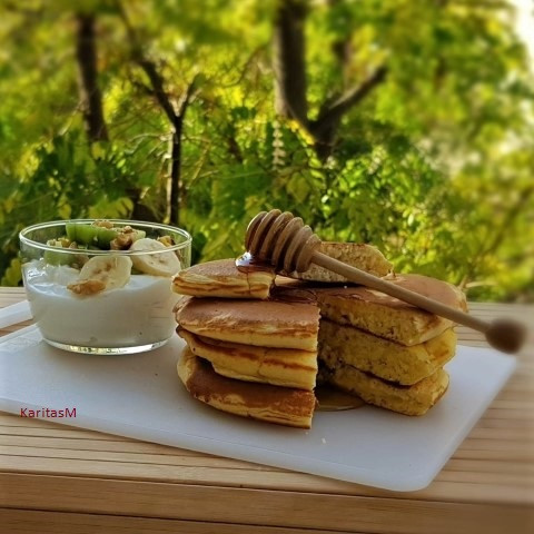 Skonsur with Honey and a side serving of Yogurt with sliced fresh fruit