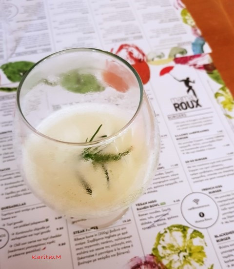 Delicious warm cocktail with fresh rosemary