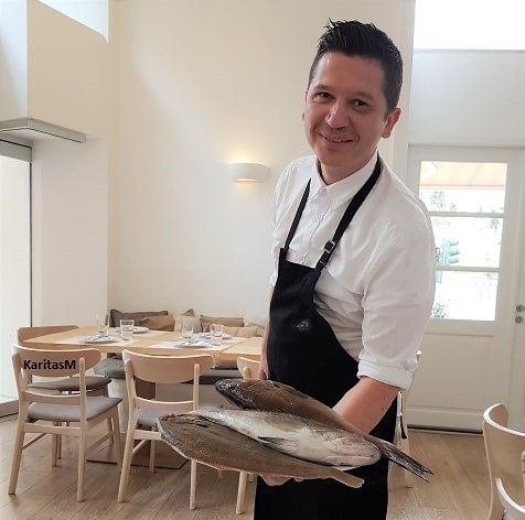 Marios (Head Waiter ) showing us the Catch of the Day!