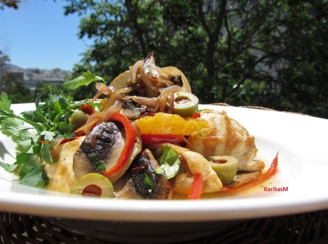 Chicken Casserole with mushrooms, orange wedges, peppers & olives