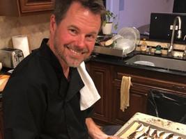 Chef glazing the chiptole mushrooms