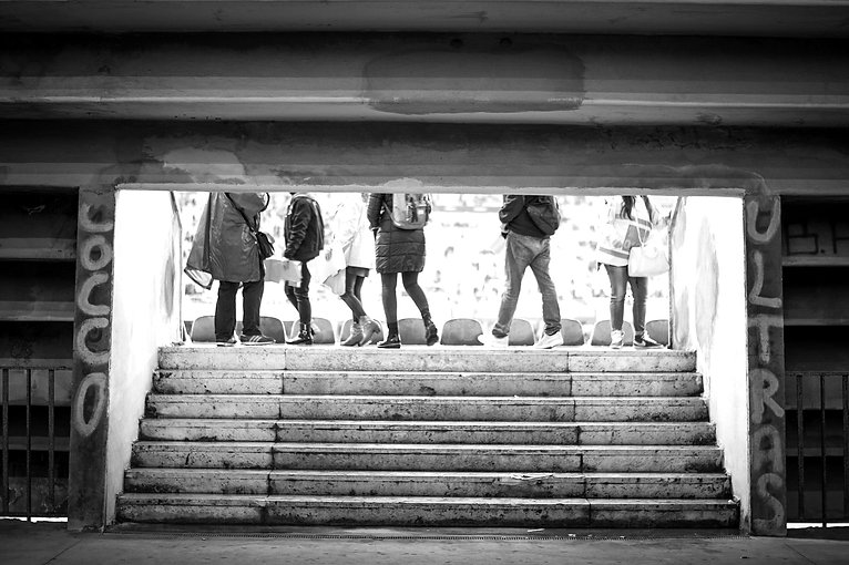 six person walking near tunnel_edited.jp