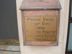 Metal beach friendly signs