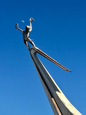 A Soviet statue of a person reaching towards the sky at Expo Georgia, in Didube neighborhood, in Tbilisi, Geogia.