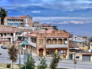 Old, renovated buildings with moutains in the background in Telavi, Kakheti, Georgia.