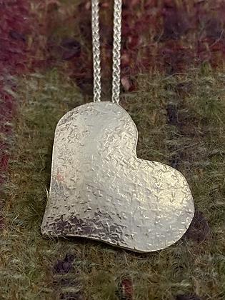 Silk textured hammered heart