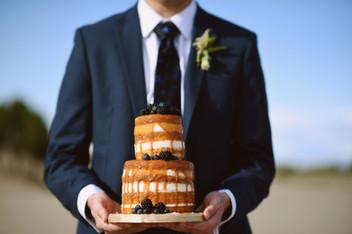 Groom with naked wedding cake
