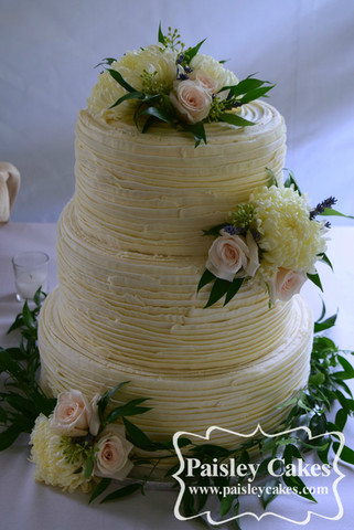 Buttercream Ruffle cake with Fresh Flowers.