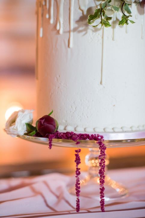 White Drip Cake with fresh flowers