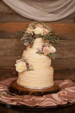 3 tiered buttercream ruffle wedding cake