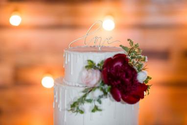 White Drip Wedding Cake with fresh flowers