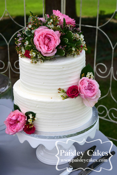 Textured Buttercream Cake with Pink and Red Flowers