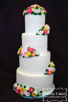 Four Tiered Textured buttercream cake with buttercream flowers.