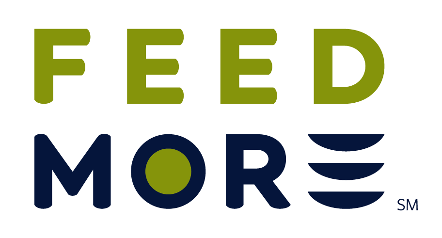 The Feed More Logo is stacked with the word FEED in light green writing on top of the word MORE in dark blue writing. The O in MORE is filled with the same light green color, and the E in More looks like three plates stacked on top of each other to represent the three horizontal lines in an E. The word more is followed by SM (Service Mark) in small subscript.