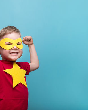 Little child superhero with yellow cloak