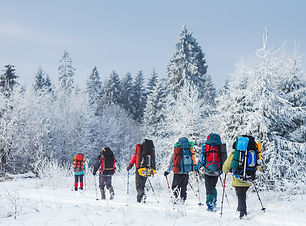 Group of trekkers on snow trail in winte