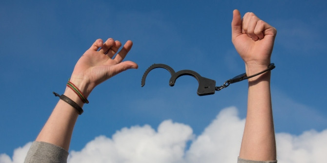 One hand free from handcuffs.