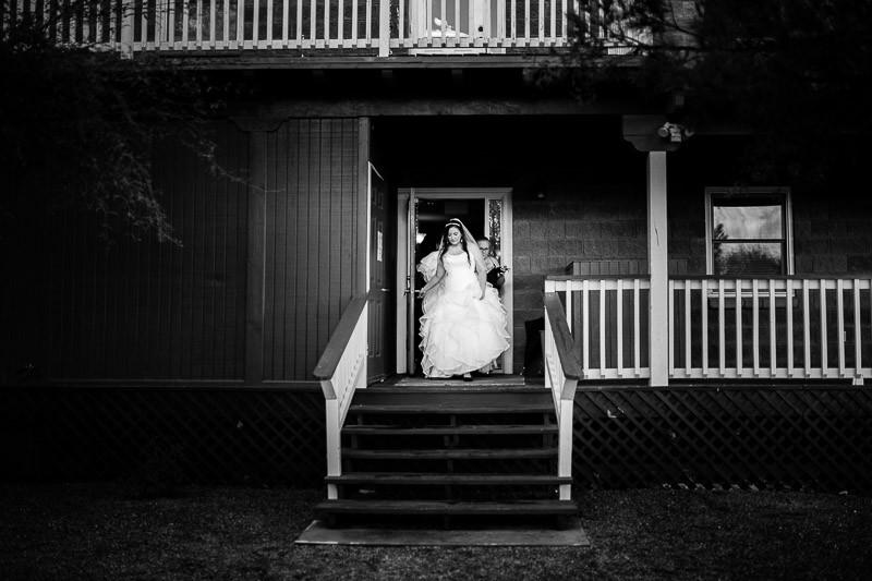 tucson wedding photographer bride black white stairs leaving hotel amado arizona