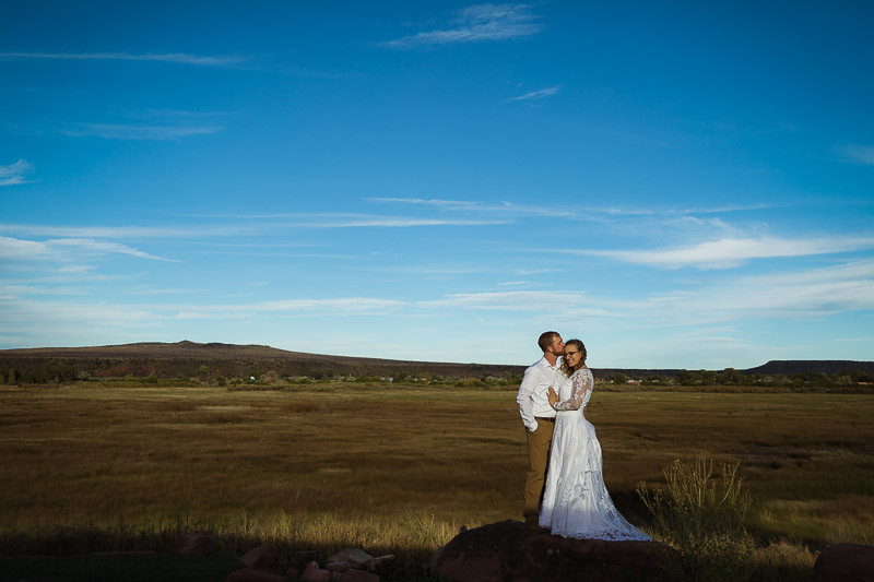 tucson wedding photographer bride groom posing amazing field