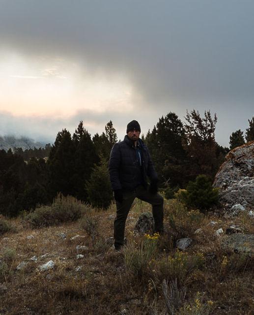 chris echavarry photographer yellowstone sunrise mountain couds hill rock