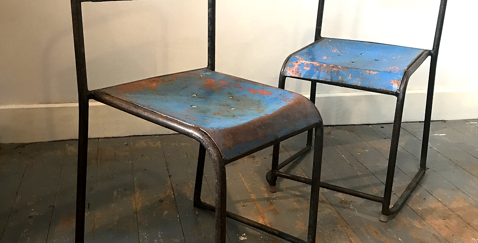 Pair of blue industrial metal stacking chairs
