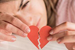 close-up-woman-holding-broken-heart_23-2