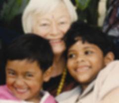 440px-Olga_Murray_with_NYOF_children.jpg