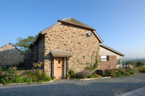 Barn conversion within curtilage of listed building