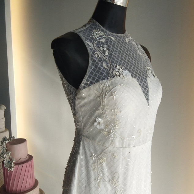 Fully beaded bridal gown with garden emb
