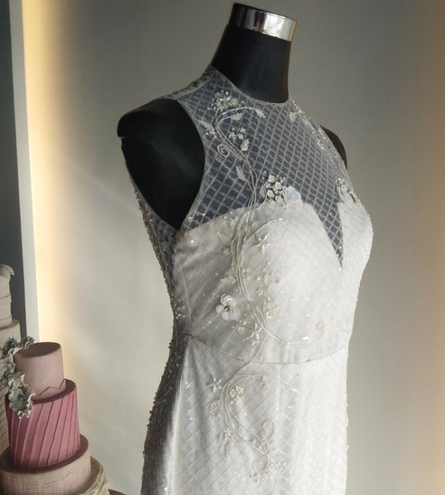 Fully beaded bridal gown with garden embellishment