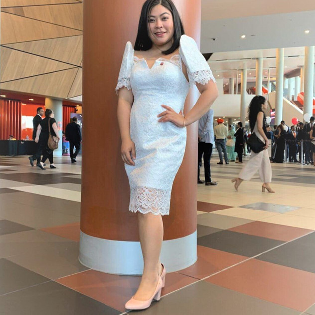 Bianca wearing a lace Filipinana for her graduation in Australia.