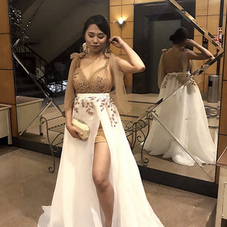 Regine in a Nude and White Sexy Gown for
