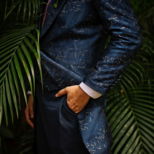 Nige in this navy blue gold floral accent penguin suit