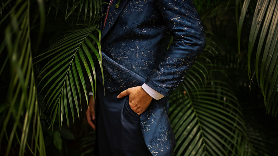Nige in a gold bloom suit in navy blue for his unique wedding.